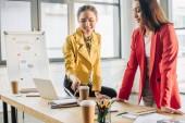 Successful businesswomen working together in modern light office