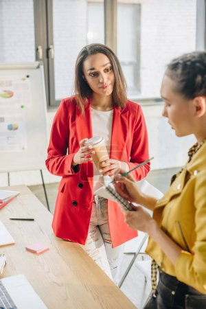 Young businesswomen working together in modern light office