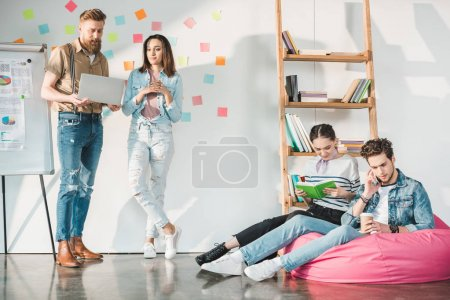 Professional business colleagues men and women during new ideas researching in modern office