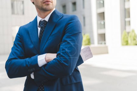 Photo for Cropped shot of businessman in stylish blue suit with crossed arms - Royalty Free Image