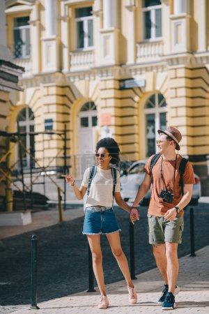 african american female tourist pointing by finger to boyfriend