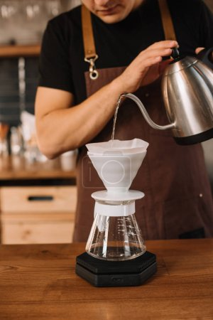 Photo for Cropped view of barista preparing filtered coffee - Royalty Free Image