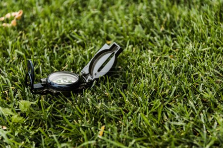 Photo for Selective focus of retro compass on green grass - Royalty Free Image