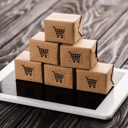 Photo for Close up of toy carton boxes on digital tablet, e-commerce concept - Royalty Free Image