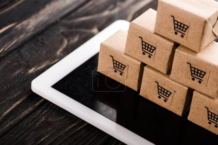 Photo for Selective focus of small carton boxes on digital tablet, e-commerce concept - Royalty Free Image