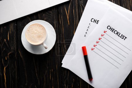 Photo for Top view of papers with checklist and red marker pen near cup of coffee on table - Royalty Free Image