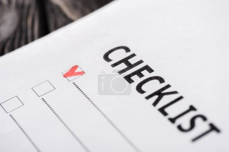 close up of checklist with red tick