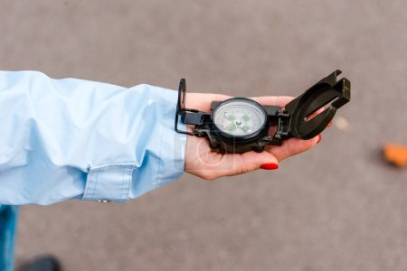 Photo for Cropped view of woman holding retro compass in hand - Royalty Free Image