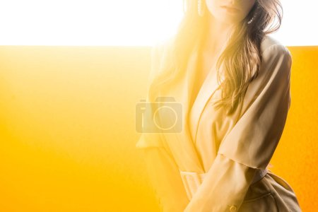 Photo for Cropped view of woman standing on orange and white - Royalty Free Image