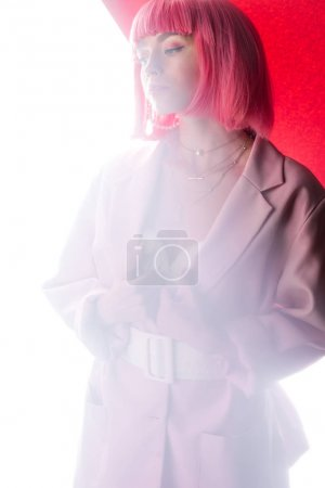 Photo for Stylish woman in blazer on pink and white - Royalty Free Image