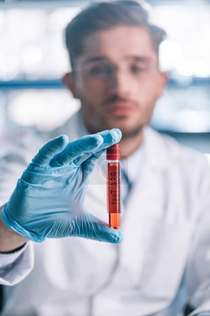 Photo for Selective focus of immunologist holding test tube with red liquid - Royalty Free Image