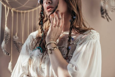 Photo for Cropped view of girl with braids in white boho dress on beige with dream catcher - Royalty Free Image