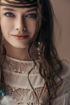 Photo pour Beautiful smiling girl with braids in white boho dress on beige - image libre de droit