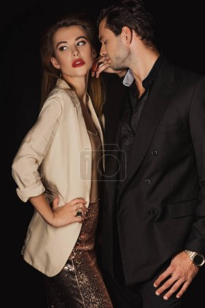 Photo for Attractive woman and handsome man in suit isolated on black - Royalty Free Image