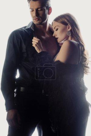 Foto de Mujer atractiva desvestirse hombre guapo aislado en blanco - Imagen libre de derechos