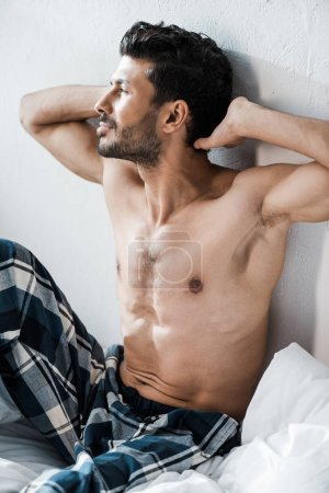 Photo for Handsome and sexy bi-racial man with hands on head in morning - Royalty Free Image