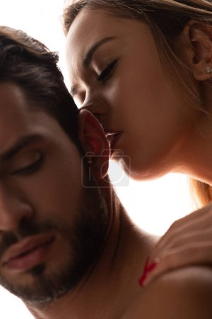 Photo pour Close up of passionate woman kissing sensual man, isolated on white - image libre de droit