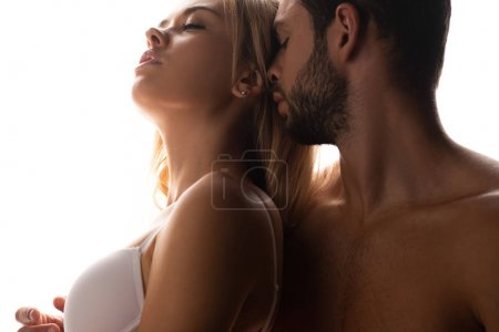 Photo pour Close up of passionate man hugging attractive woman, isolated on white - image libre de droit