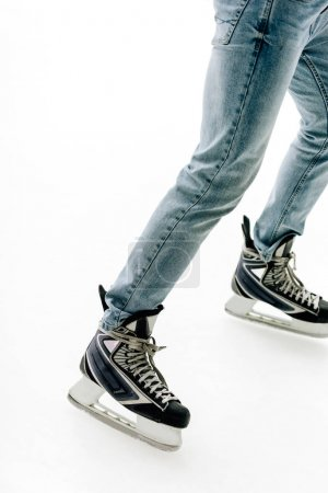 Photo for Cropped view of man in jeans and skates skating on rink - Royalty Free Image