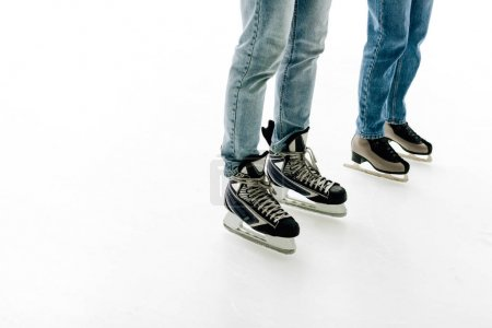 Photo for Cropped view of young couple in skates skating on rink - Royalty Free Image