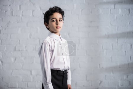Photo for Cute jewish boy in white shirt looking away - Royalty Free Image