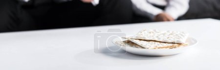 Photo for Panoramic shot of matza on plate, on wooden plate - Royalty Free Image