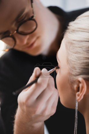 Photo for Selective focus of Makeup Artist doing makeup to model on backstage - Royalty Free Image