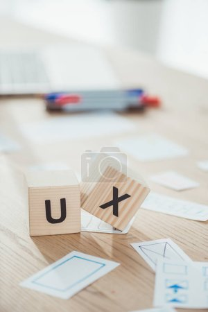 Photo for Selective focus of cubes with ux letters and website app layouts on wooden table - Royalty Free Image