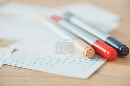 Photo for Selective focus of pens on user experience design sketches on wooden table - Royalty Free Image