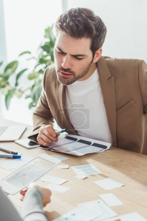 Photo for Selective focus of designers sketch planning ux app for mobile web site in designer studio - Royalty Free Image