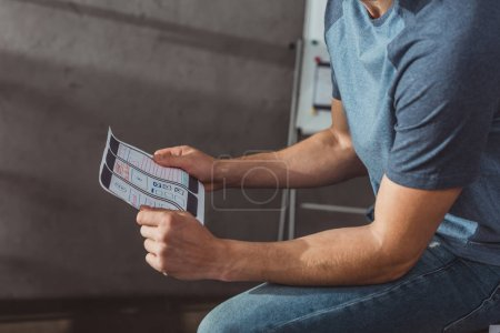 Photo for Cropped view of ux designer holding mobile website template in office - Royalty Free Image
