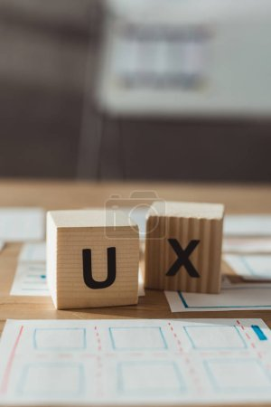 Photo for Selective focus of cubes with ux letters and layouts of user experience design on table - Royalty Free Image