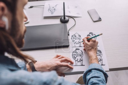 Photo for Selective focus of illustrator drawing cartoon sketches - Royalty Free Image