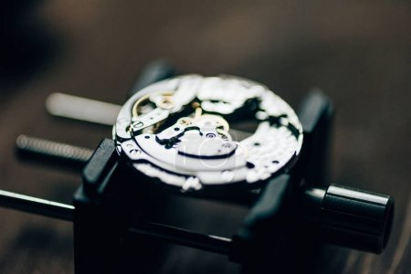 Photo for Close up view of open mechanical wristwatch on movement holder - Royalty Free Image