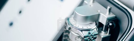 Photo for Selective focus of wristwatch in watchpress, panoramic shot - Royalty Free Image