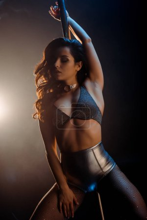 Photo for Beautiful stripper in underwear pole dancing on black - Royalty Free Image