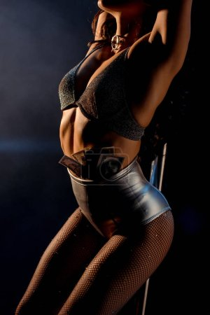 Photo for Cropped view of sexy stripper with money in panties on blue - Royalty Free Image