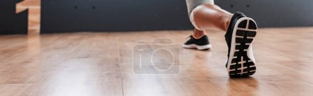 Photo for Low angle view of zumba dancer practicing in dance studio, panoramic shot - Royalty Free Image