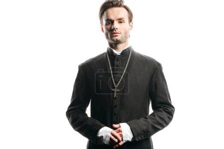 Photo pour Jeune prêtre catholique confiant regardant la caméra isolée sur blanc - image libre de droit