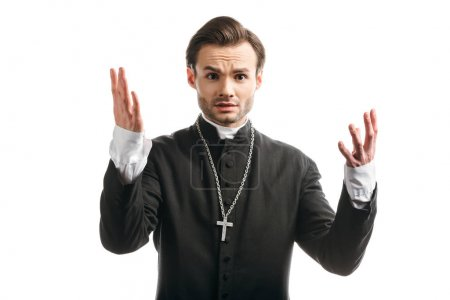 Photo for Discouraged catholic priest showing shrug gesture while looking at camera isolated on white - Royalty Free Image