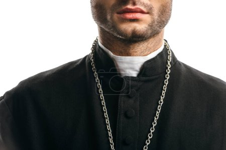 Photo pour Cropped view of catholic priest in black cassock standing isolated on white - image libre de droit