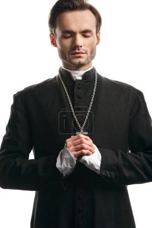 Photo pour Prêtre catholique concentré priant les yeux fermés isolé sur blanc - image libre de droit