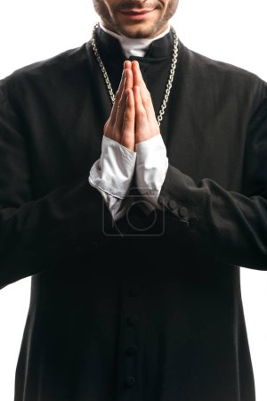 Photo for Partial view of catholic priest in black cassock praying isolated on white - Royalty Free Image