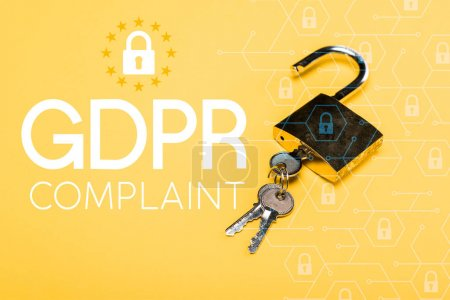 Photo for Padlock with keys near gdpr complaint lettering on yellow - Royalty Free Image