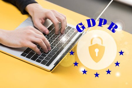 Photo for Cropped view of hacker using laptop near gdpr lettering - Royalty Free Image