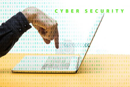 cropped view of man pointing with finger at laptop near cyber security lettering on white