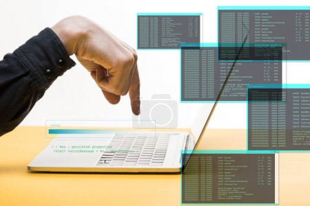 Photo for Cropped view of hacker pointing with finger at laptop near data illustration on white, cyber security concept - Royalty Free Image