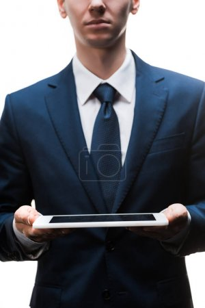 cropped view of businessman holding digital tablet isolated on white