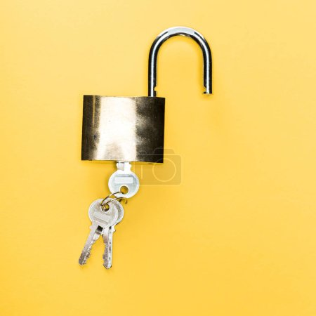 Photo for Top view of padlock with keys isolated on yellow - Royalty Free Image