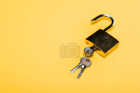 Photo for Padlock with keys isolated on yellow - Royalty Free Image